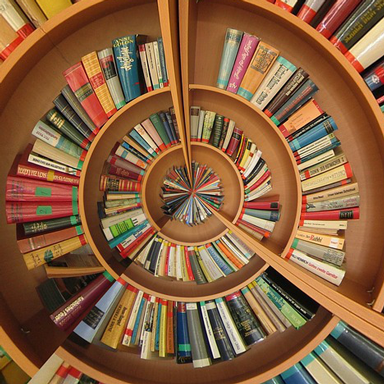 Spiral of books on shelves
